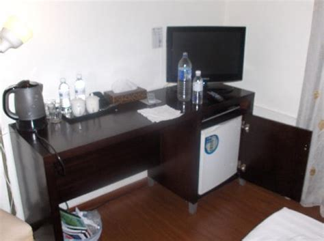 desk with mini fridge picture of hotel 34 singapore