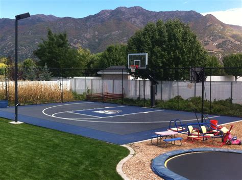 backyard pool and basketball court this pro dunk diamond basketball system sits next the