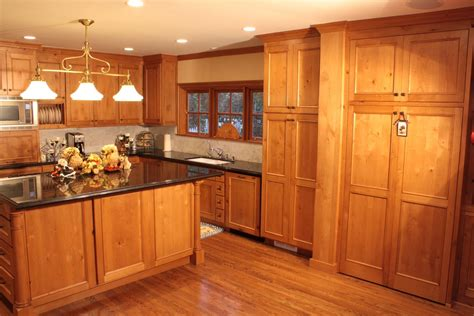 made knotty pine kitchen and entertainment center by