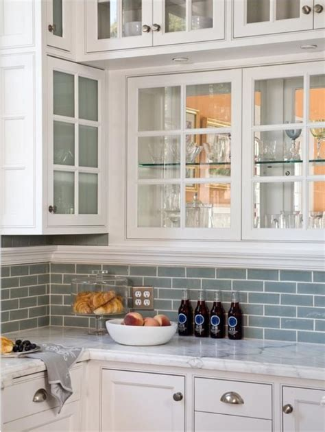 kitchen with subway tile backsplash white cabinets with frosted glass blue subway tile