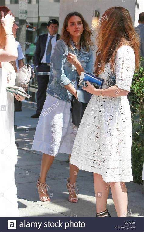 Alba Wears White by Alba Wears A White Dress And Denim Jacket To A