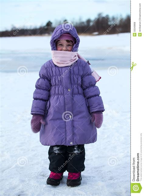 wrapped in warm clothing child standing outdoor