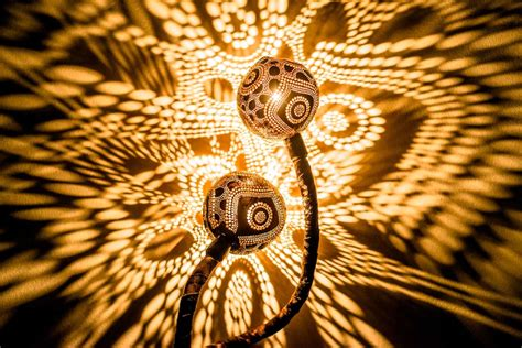 lights that cast patterns serpentine ls drilled from coconut shells cast dazzling