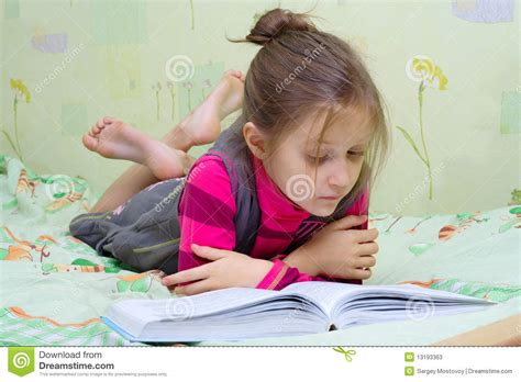 picture of a child reading a book child reading a book stock photos image 13193363