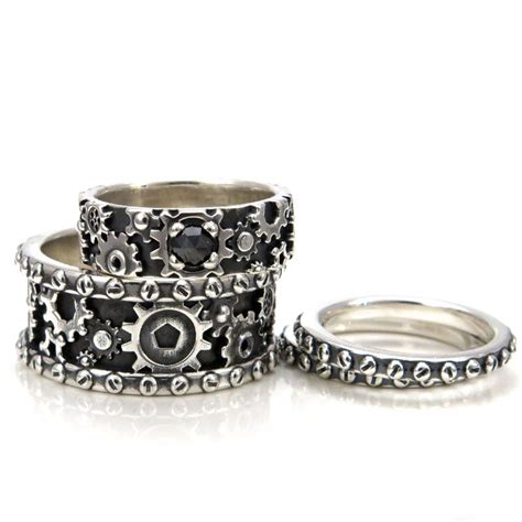 his and hers steunk gear ring set by swankmetalsmithing