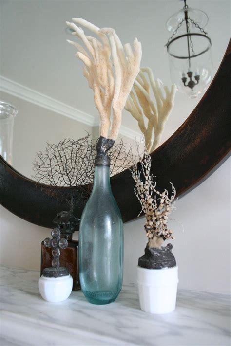 In A Bottle Seashells Sands Home Decor details of sea encrusted bottles coastal decor