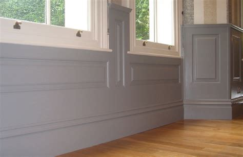 painted wood panel walls share