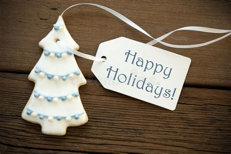 happy holidays   christmas tree cookie stock photo image
