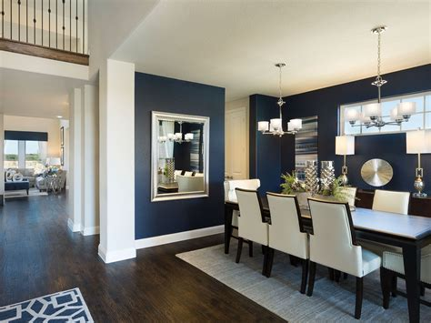 meritage homes model home lantana beautiful navy walls dining room with ivory dining chairs