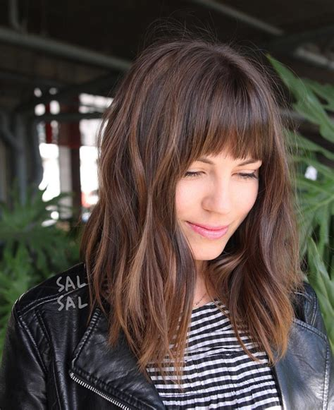 lob hairstyle pictures with bangs women s layered brunette a line lob with fringe bangs and