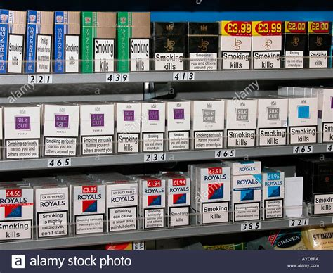 Sle Size Paket packets of cigarettes on sale in newsagent shop uk stock photo royalty free image 1825017 alamy
