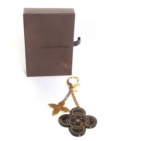 louis vuitton stipply flower bag charm tortoise 94850