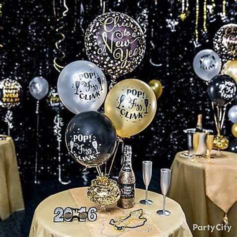 pictures of new year decorations deck out the table in all the glitters in gold silver