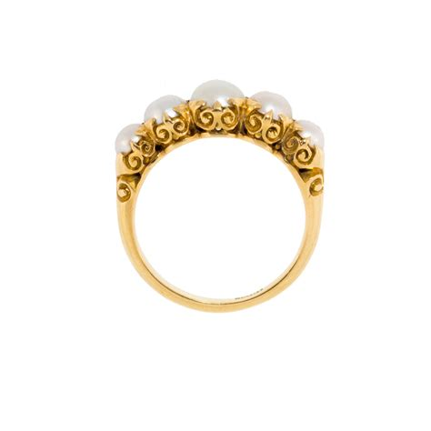 antique a pearl ring in 18 ct gold half hoop stacker