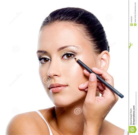 Eyeshadow Pensil applying eyeliner on eyelid with pensil stock image