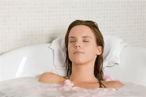 women in the bathtub woman relaxing in tub