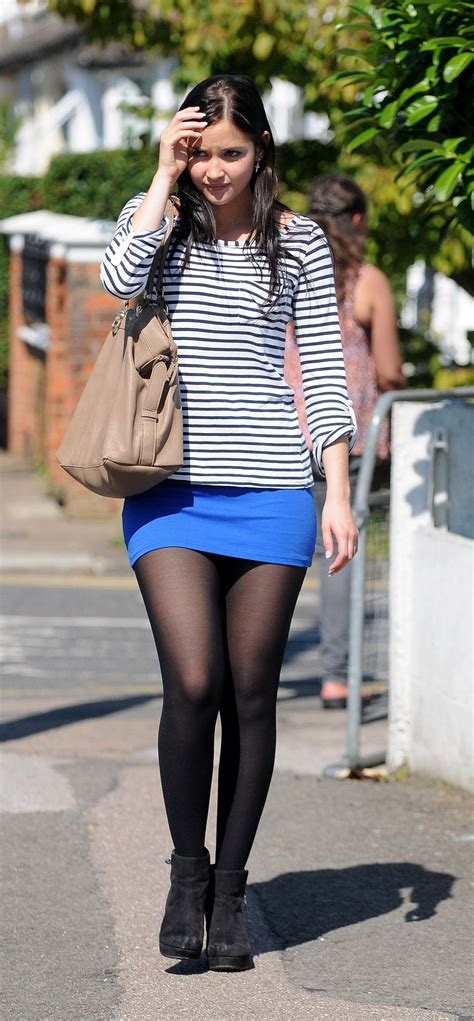 jacqueline jossa in black and tight blue skirt