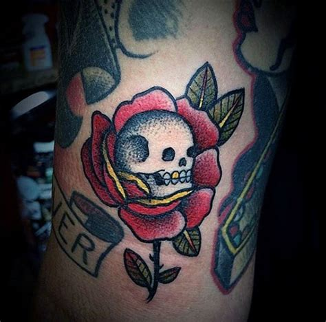 old traditional red rose with small skull colored