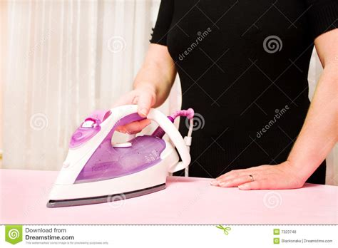 Baseball Niron Cloth ironing clothes with steam iron royalty free stock photos