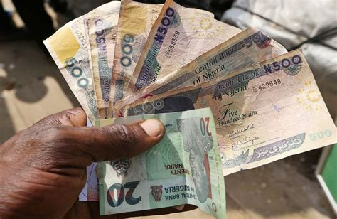 nigeria s half measures on currency are only half working bloomberg