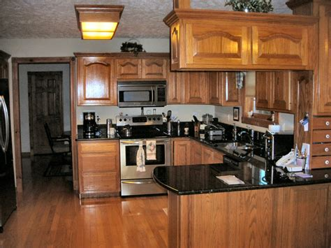 dark oak kitchen cabinets lake area custom with guest house shop pole barn near