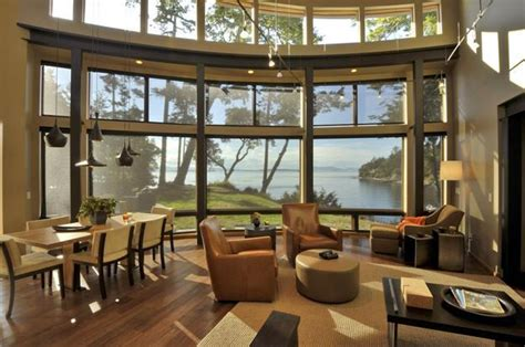 house with large windows beautiful lakefront house with large windows surrounded by gorgeous trees