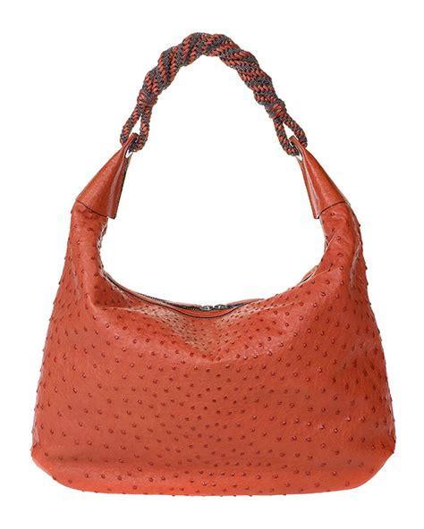 Other Designers Purse Deal Oscar De La Renta Tortoise Python Clutches by Oscar De La Renta Bag Purseblog