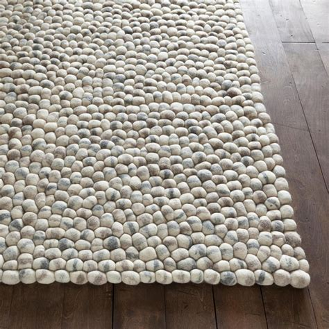 rug for gray stones wool rug in light gray by chandra rugs