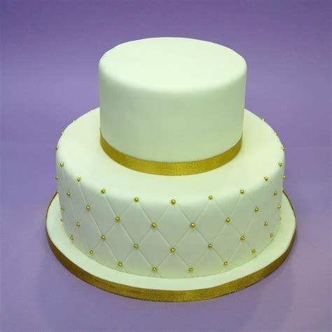 tarta fondant dos pisos tarta de dos pisos con motivos en dorado y efecto