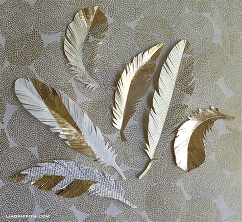 Paper Feathers - diy paper feathers in gold lia griffith