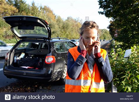 woman driver on the phone for car breakdown car breakdown on a highway woman female driver wearing