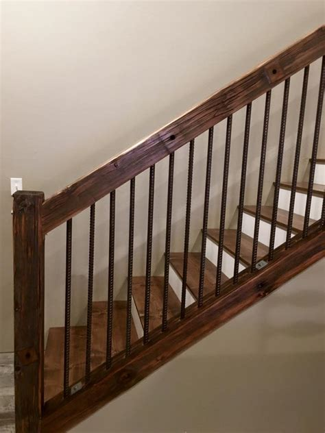 banister pole rustic old utility pole cross arms reclaimed into stair railing with rebar used as