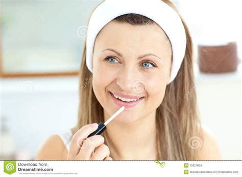 women using the bathroom attractive woman using lipgloss in the bathroom stock images image 15621804