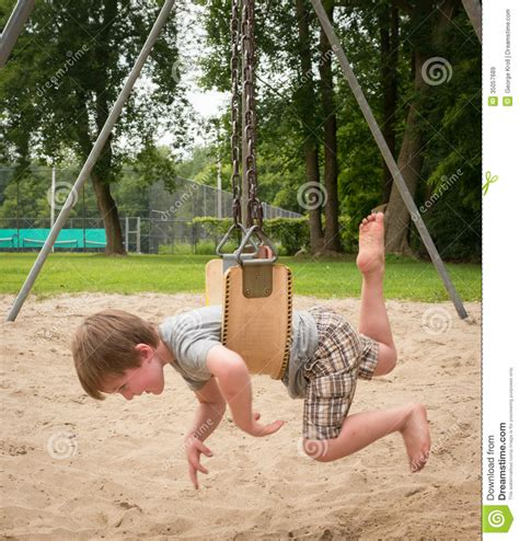 young swing stomach swinging stock image image of legs kiddie swing