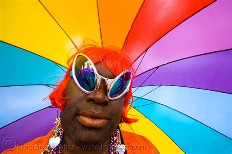 black drag queen with rainbow umbrella