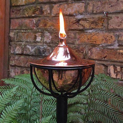 copper bowl burning garden torch by garden