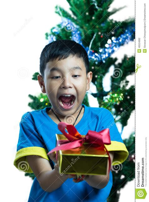 how to get a christmas gift for my child asian kid exciting to get a gift stock photo image of child smiling 46524892