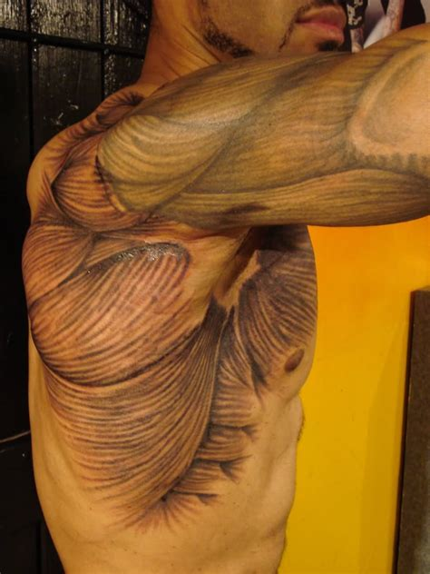 tattoos and muscles muscles on siderib shoulder and arm