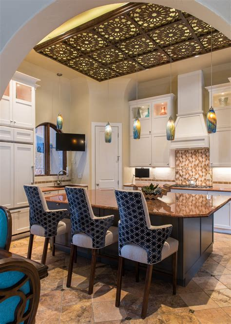 moroccan inspired kitchen features decorative ceiling