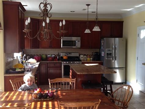 how to choose lighting for open concept choosing kitchen light fixtures that work together emily