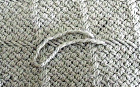 in knitted garments how to fix a snag in a sweater or knitted garment