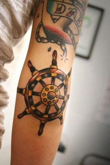 sailor jerry ship tattoo designs ships wheel just below shiphelm ink