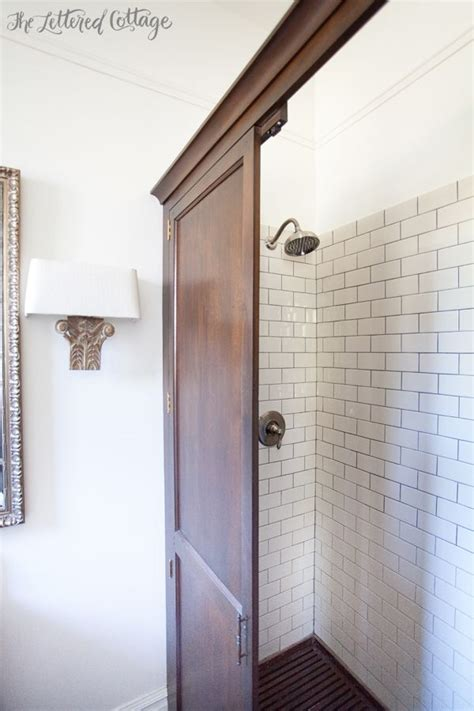 shower in armoire house guest bathroom