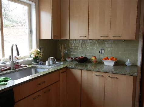 green glass subway tile with maple cabinets kitchen