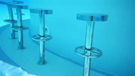 Pool Stool by Metal Bar Chairs Underwater In Blue Pool And