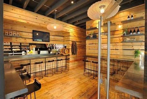 coffee shop wooden interior design wooden paneling wall with black metal bar stools for warm