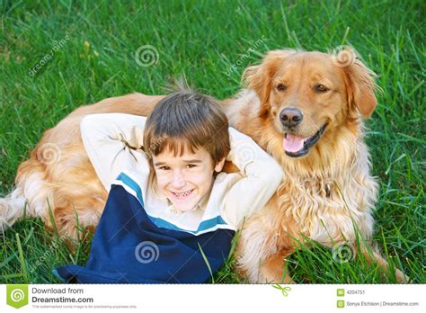 golden retriever with boy boy and golden retriever stock image image 4204751