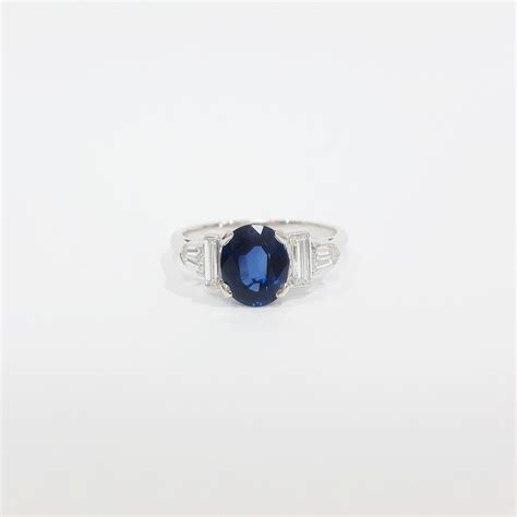 platinum sapphire ring set with shoulders martin