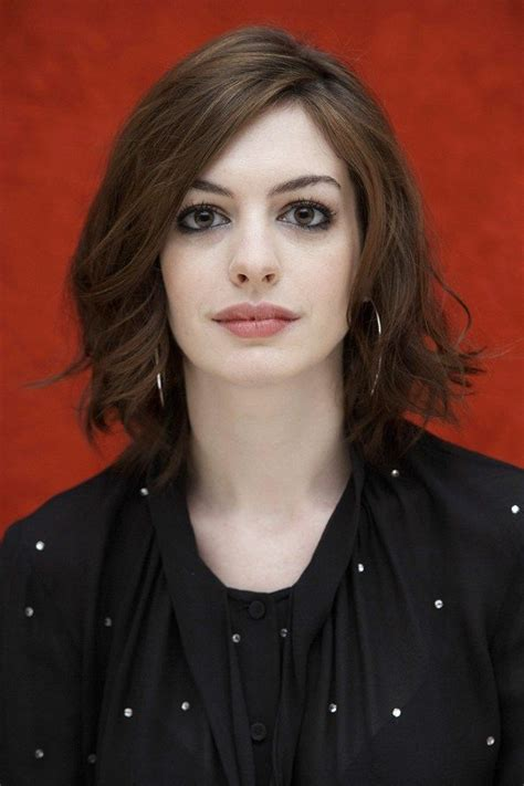 carol alt long haircut angled on the sides and falling anne hathaway wavy bob like the long side bangs and i