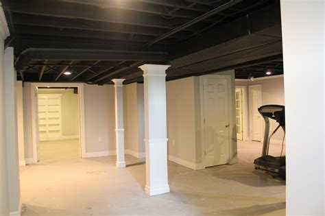 basement remodel with painted exposed ceiling